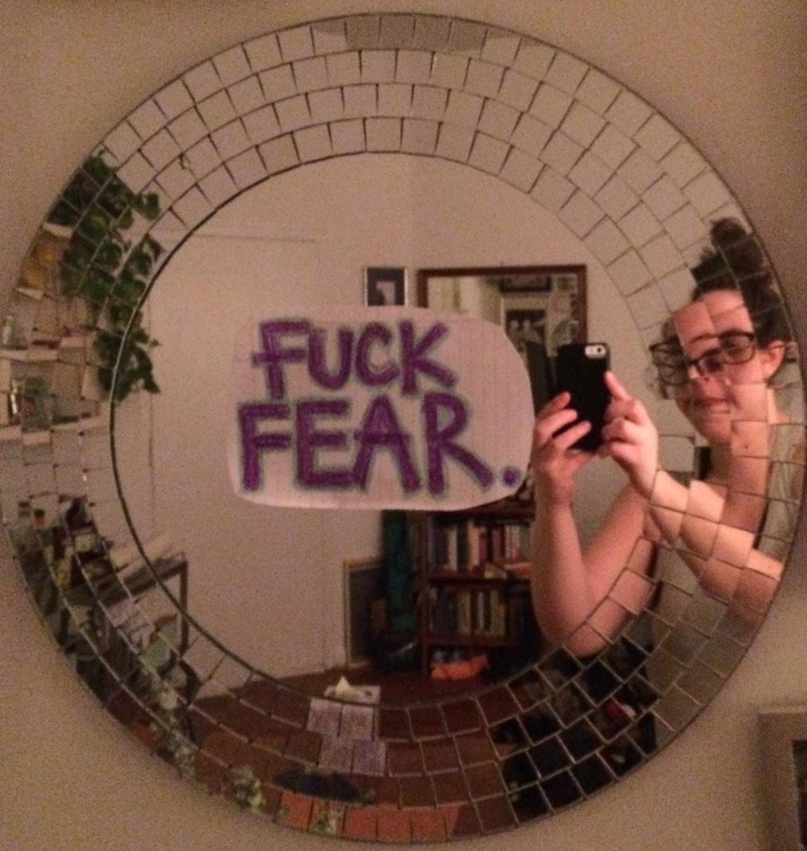 mirror that says 'fuck fear'