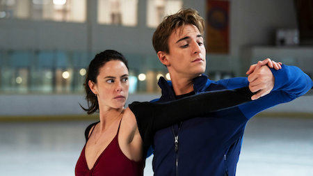 Photo from Netflix's Spinning Out with the two leads dancing on the ice.