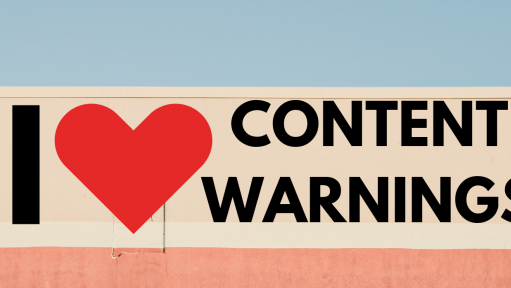 "A side of a building that reads ""I heart content warnings."""